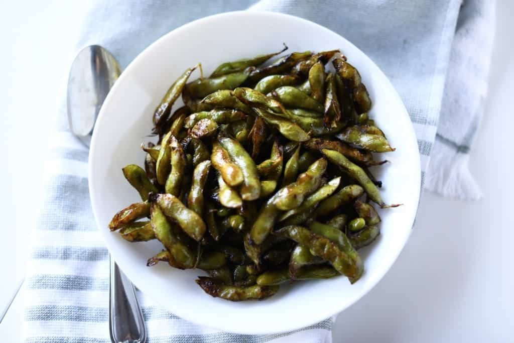 Sesame Soy Roasted Edamame with sesame oil and soy sauce plated and ready to eat!