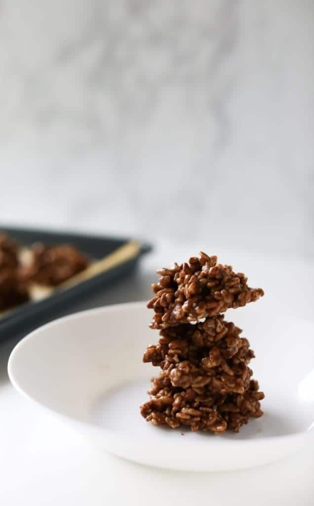 cocoa crunch honey clusters frozen and ready to eat on a white plate #homemadechocolatesauce #cocoaricekrispies #nobakedessert