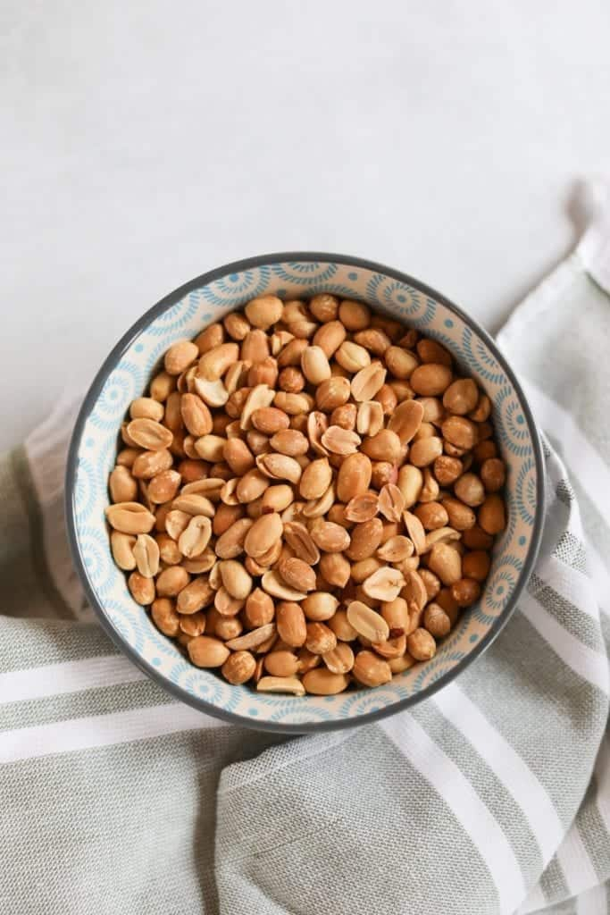 oven roasted golden roasted peanuts fresh out of the oven on grey and white striped towel
