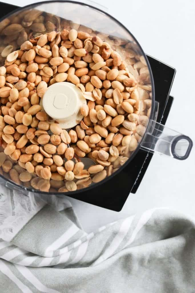 oven roasted peanuts in food processor ready to blend into peanut butter GOLD!