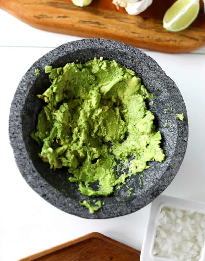 smashed avocado in mocaljete (first step for guacamole)