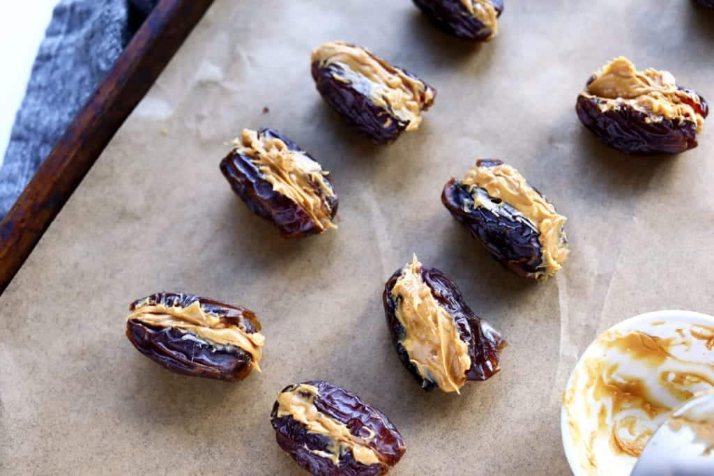 healthy snicker dates step 1 - pit dates and stuff with peanut butter #snickerdates #healthysnickers #chocolate #dessert #chocolate #chocolatecovereddates #homemadesnickersrecipe #chocolatecoveredsnickerdates #healthydessertrecipes