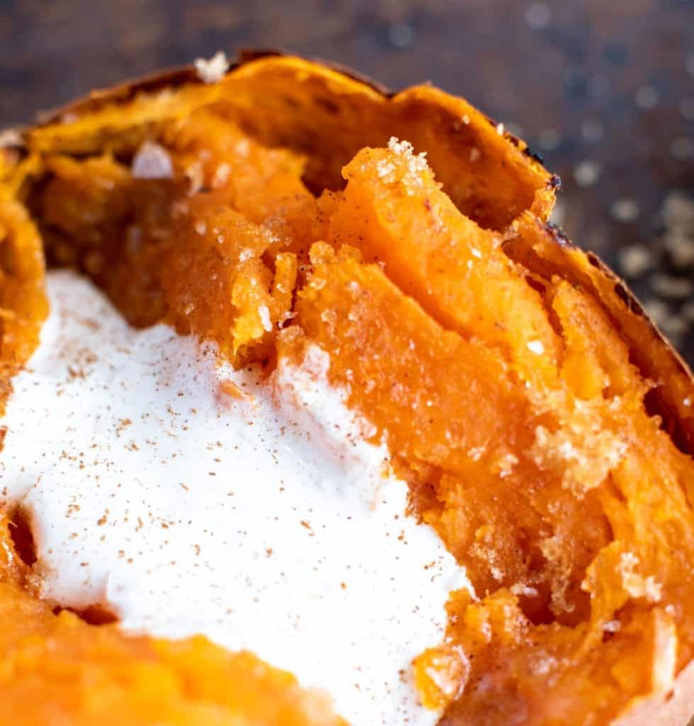 up close picture of baked sweet potato on baking sheet cut in half with melting butter and creamy marshmallow fluff sprinkled with sea salt and brown sugar then dusted with cinnamon! #feedfeed #f52grams #BuzzFeast #SWEEEEETS #huffposttaste #ImSoMartha #surlatable #mywilliamssonoma #thekitchn #eeeeeats #bhgfood #eattheworld #bakersofinstagram #christmassides #foodandwine #foodgawker #bareaders #fwx #ABMfoodie #beautifulcuisines #holidaysides #eatingfortheinsta #foodwinewomen #yahoofood #foodblogfeed #foodblogeats #theeverygirl #thatsdarling #dailyfoodfeed #foodphotography #bingeworthybites #foodblogeats #loadedbakedpotato #sweetpotato #sides #easysides #easyrecipes