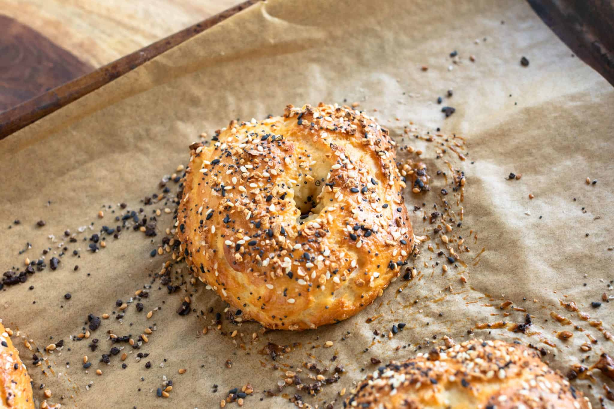 Easy homemade everything bagel golden brown after baking and fresh out of the oven cooling off #breakfast #easyrecipes #homemadebagels #everythingbagels #weightwatchers