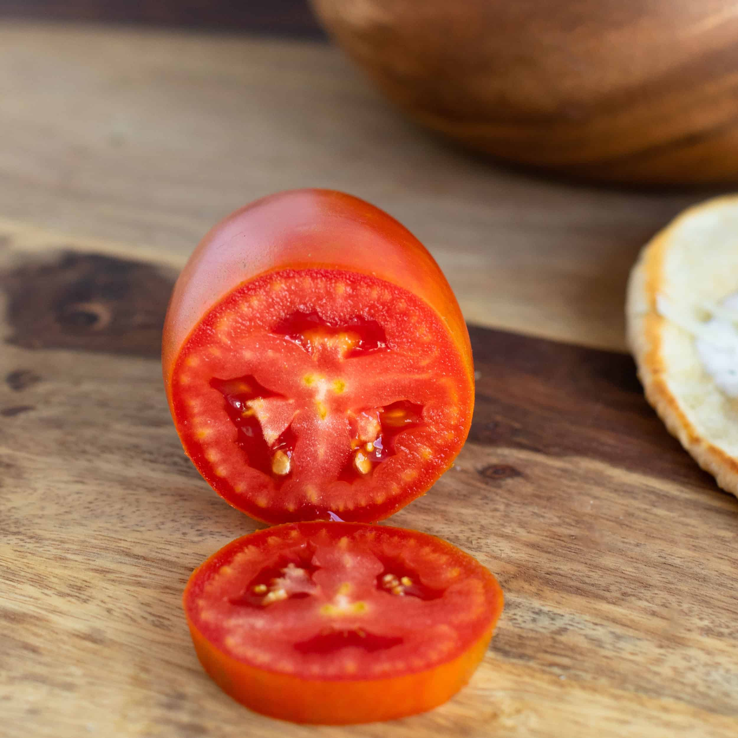 upclose pic of home grown san marzano tomato sliced