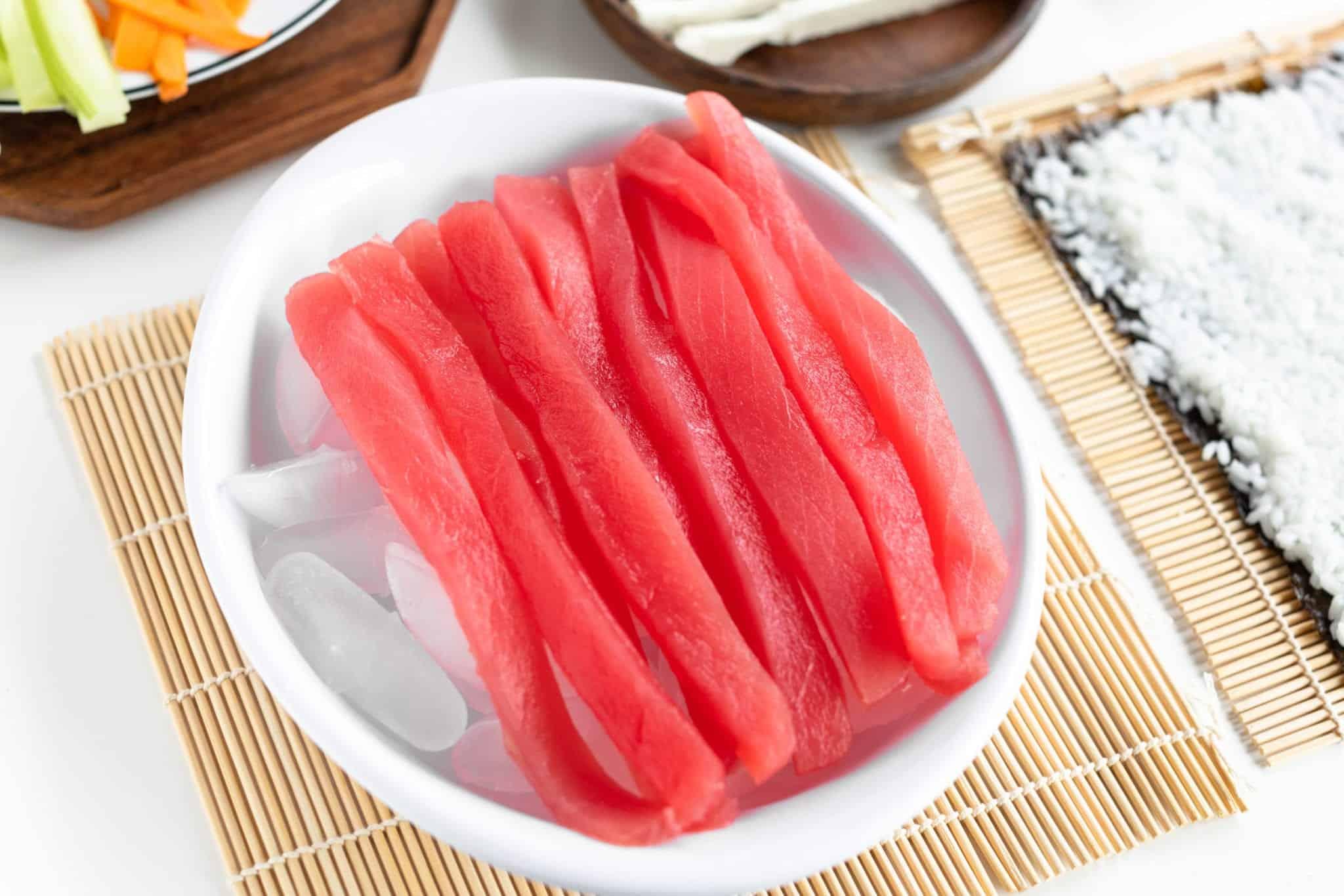 Upclose image of ahi tuna sliced thin over ice #sushi #spicytunamaki #sushirecipe #spicytuna #sushirollrecipes #spicytunamaki #crunchyspicytunaroll #bingeworthybites