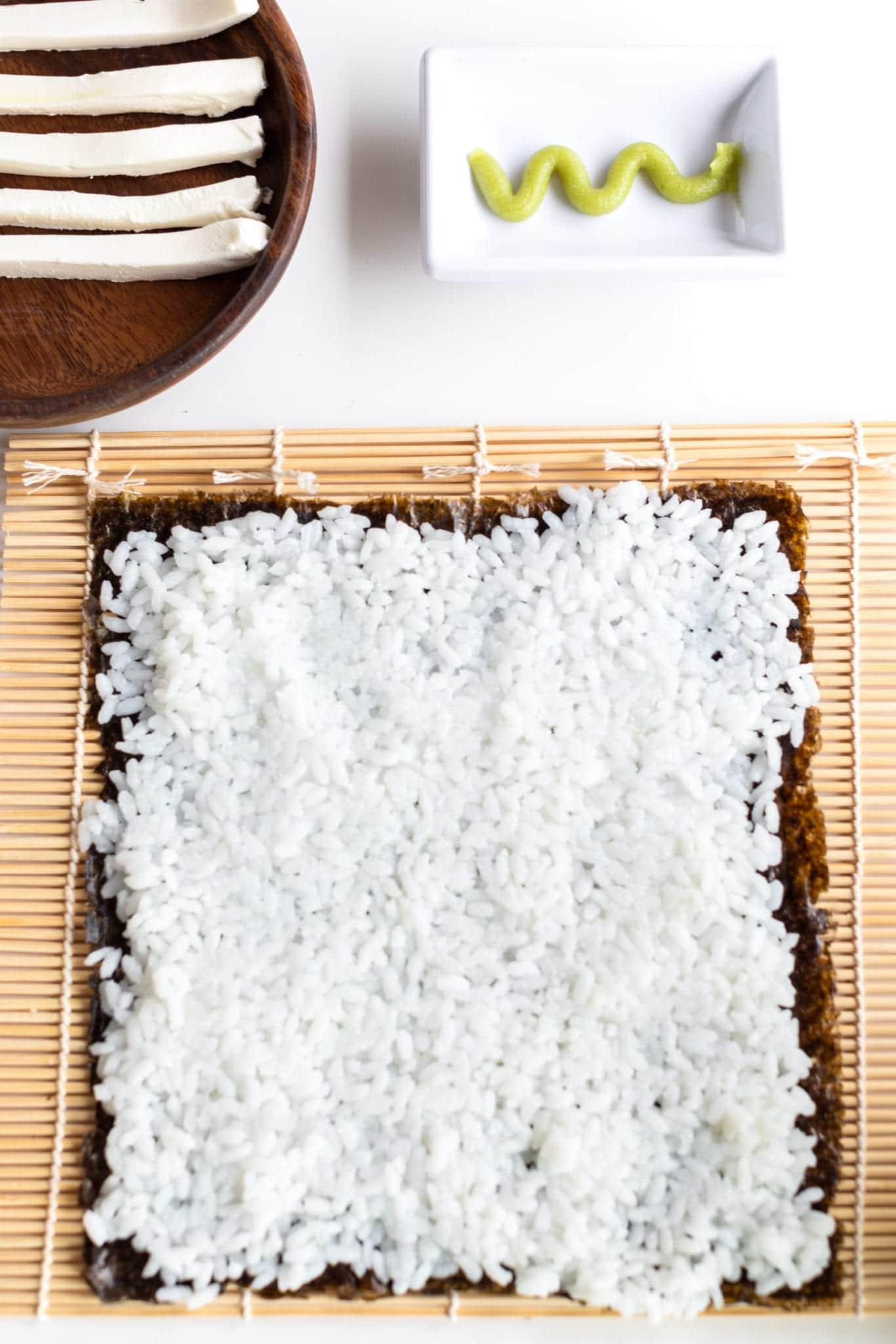tuna roll step by step bamboo mat with nori, rice spread thin ready to add ingredients #sushi #spicytunamaki #sushirecipe #spicytuna #sushirollrecipes #spicytunamaki #crunchyspicytunaroll