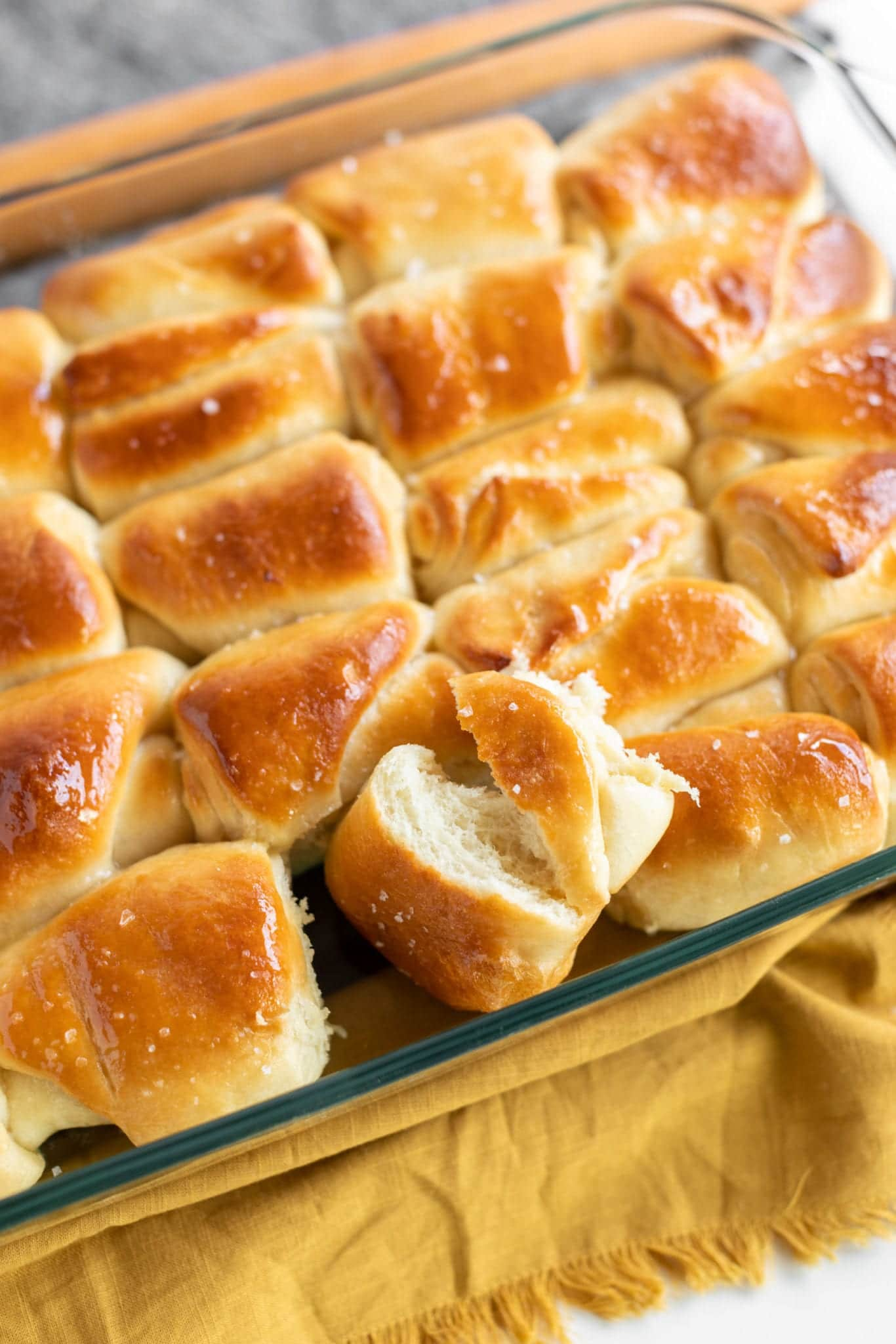 freshly baked flakey sea salt honey butter parker rolls