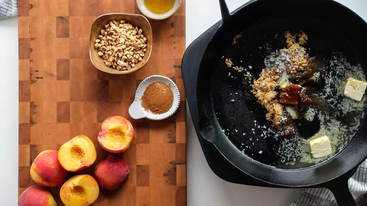 Ingredients to make Vanilla Bourbon Peaches and Mascarpone Whipped Cream: peaches, bourbon, hazelnuts, vanilla bean paste, cinnamon, nutmeg, butter, brown sugar, sea salt flakes. Butter, brown sugar, sea salt flakes and vanilla in skillet over medium heat.
