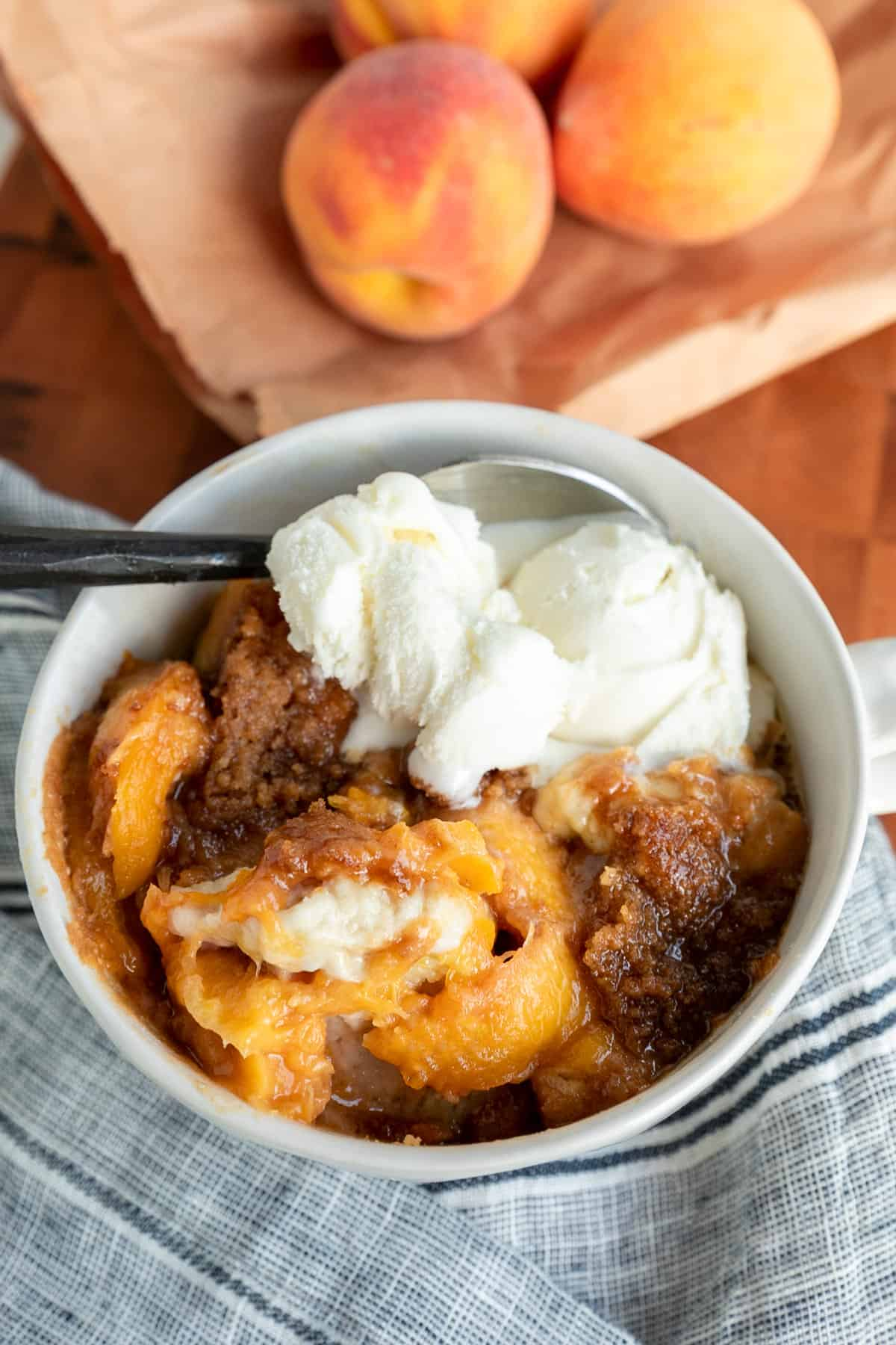 Buttermilk Biscuit Peach Cobbler with vanilla ice cream on top